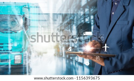 Business Logistics concept, Businessman manager using tablet check and control for workers with Modern Trade warehouse logistics. Industry 4.0 concept #1156393675