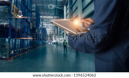 Business Logistics concept, Businessman manager using tablet check and control for workers with Modern Trade warehouse logistics. Industry 4.0 concept #1396524062