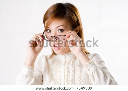 business looking woman with spectacles with a exaggerated surprise expression