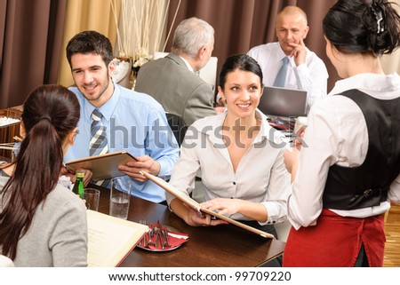 Business lunch executive people looking menu  waitress taking order restaurant