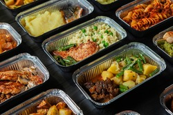 Business lunch in eco plastic container ready for delivery.Top view. Office Lunch boxes with food ready to go. Food takes away. Catering, brakfast.