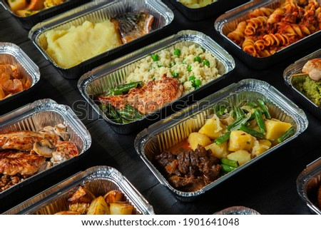 Business lunch in eco plastic container ready for delivery.Top view. Office Lunch boxes with food ready to go. Food takes away. Catering, brakfast.  Foto d'archivio ©