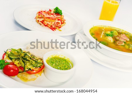 Business lunch on a white background, three dishes