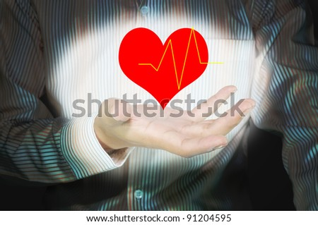 Business male hand hold heart and heart pulse