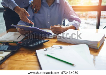 Business man accountant working hard of accounting financial report of annual 2017 with tax paperwork or job order product. Stock photo ©