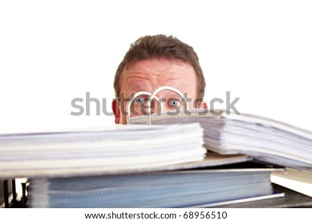 Business man afraid of tax audit hiding behind files