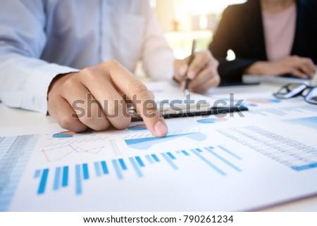 Business man analysis data document