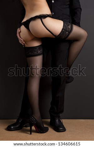 Business man and a sexy young woman in lingerie. Concept about work and pleasure - stock photo