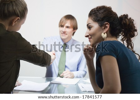 Business man and business woman shaking hands