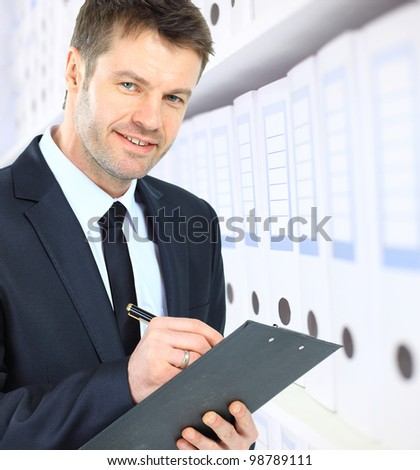 business man and folders - stock photo