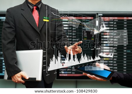 Business man and graph report on digital tablet