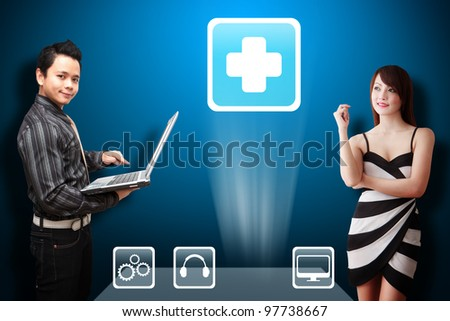 Business man and secretary look at the First Aid icon