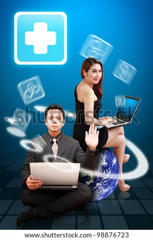 Business man and secretary present the First Aid icon : Elements of this image furnished by NASA - stock photo