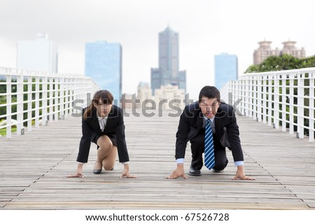 Business man and woman  getting ready for race in business