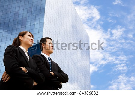 business man and woman  looking away