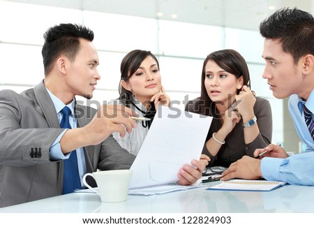 business man and woman meeting in the office discussing something