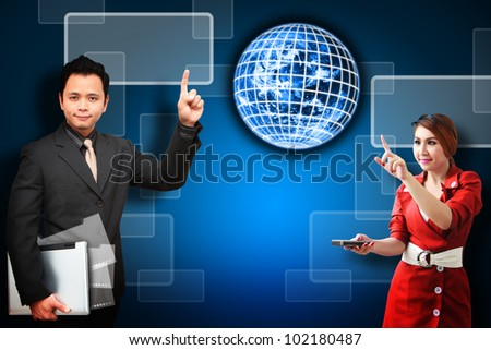 Business man and woman point to Digital world : Elements of this image furnished by NASA