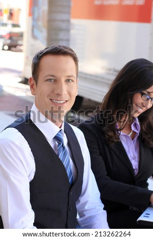 Business Man and Woman Team Smiling and Wearing Suits and Working