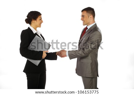 Business man and women standing and shaking hands