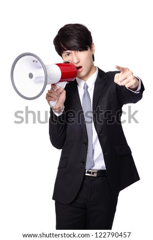 Business man angry screaming loudly in a megaphone isolated on white background, model is a asian male