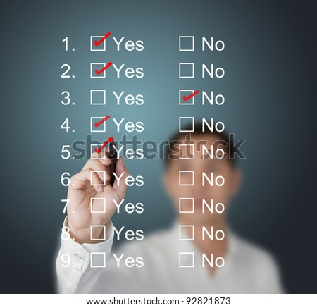 business man answering questions by make mark on yes or no boxes