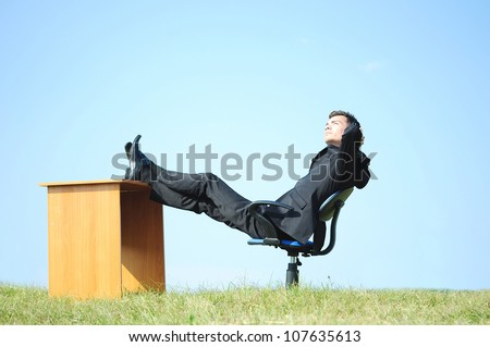 Business man at desk in nature - stock photo