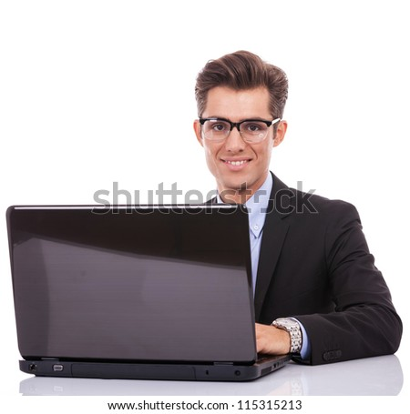 Business man at his desk with a laptop, isolated on white background - stock photo