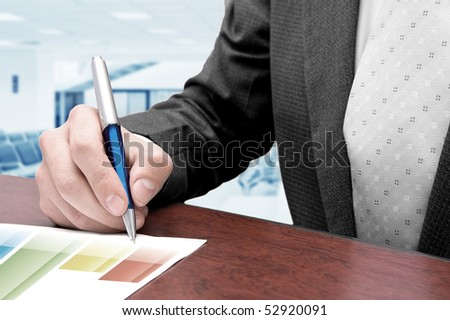 Business man at office analyzing charts
