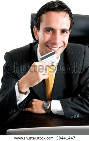 Business man at office paying online with his credit card