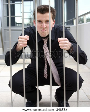 business man behind bars