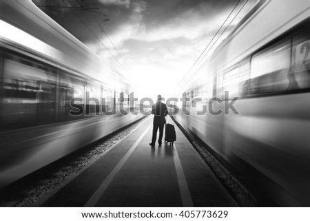 Business man between two fast trains, black and white #405773629
