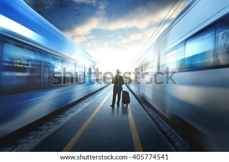 Business man between two train at the train station #405774541