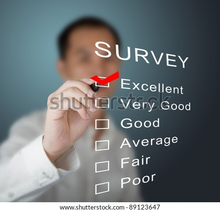 business man checking  excellent on survey form
