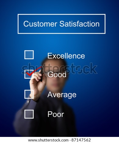 business man checking  good on customer satisfaction survey form