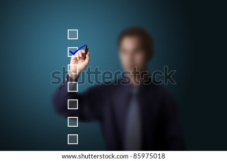 business man checking on a checklist box