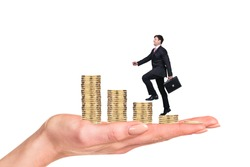 Business man climbing on coins ladder on isolated background