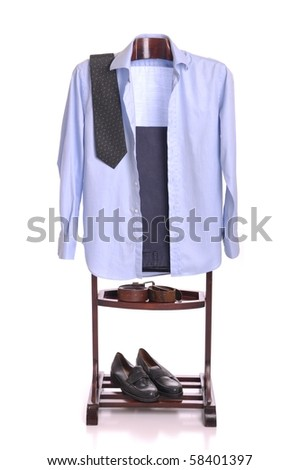 business man clothing on a wooden hanger with shirt, tie, trousers, belts and shoes (isolated on white background)