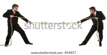 Business man concept of playing tug of war with himself.