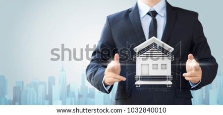 business man create design house or home, architecture building concept #1032840010