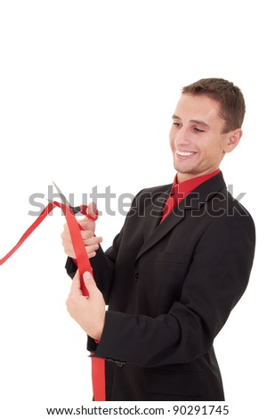 business man cutting a red ribbon with  scissors