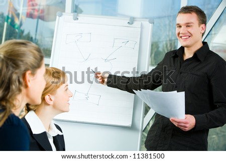 Business man doing a presentation at meeting - stock photo