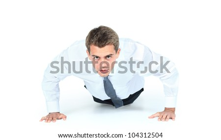 Business man doing push-ups - stock photo