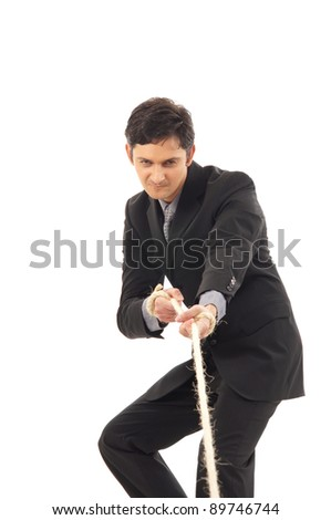 Business man drags the rope isolated on white