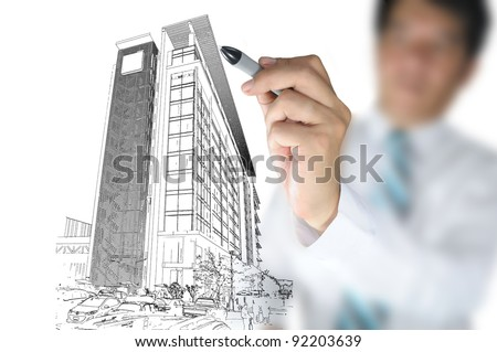 Business man draw building