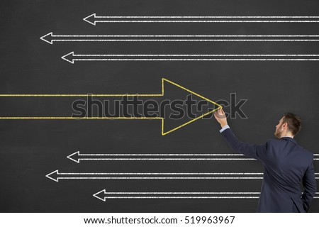 Business Man Drawing Change Concepts on Chalkboard
