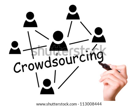 Business man drawing crowd sourcing concept to screen.
