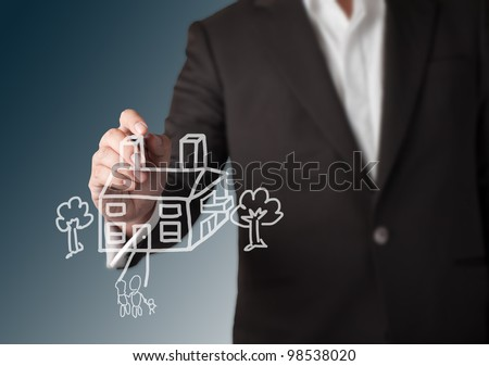 Business man drawing house with tree and family