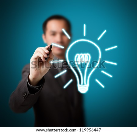 business man drawing idea light bulb