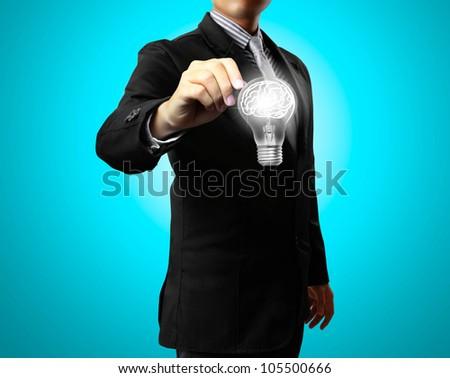 Business man drawing light bulb