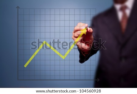 business man drawing over target achievement graph